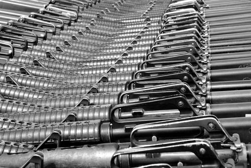 guns, M16 rifles, weapons, arms - shutterstock_125587409