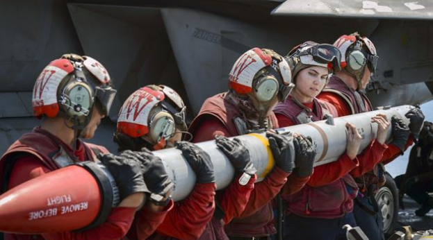 loading missile onto Super Hornet on USS Nimitz (Inherent resolve)