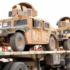US Army humvees on truck