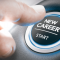 Finger pressing a new career start button, from Olivier Le Moal, Shutterstock