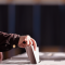 Hand of a person casting a vote into the ballot box during elections, from Roibu, Shutterstock